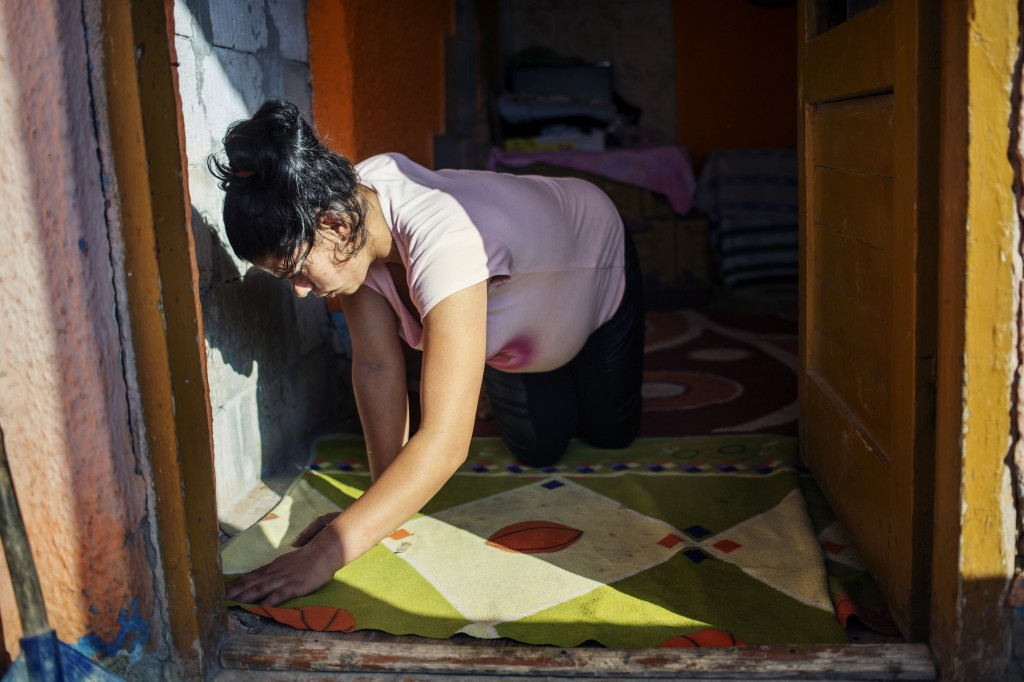 Mariana, an underage mother pregnant with her second child doing daily household chores, as seen in Valcea county, on September 11, 2016.  Mariana was rapped by her step father, to whom she mothered a child and stabbed by her own mother when she learned about the rape. Mariana is part of World Vision program Mothers for Life, Life for Mothers.